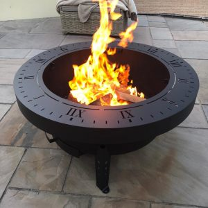 Hand fabricated Fire Pit, BBQ & Sundial with fire lit